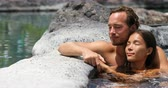casal : Romantic couple relaxing together in hot tub whirlpool jacuzzi luxury resort spa retreat. Luxurious hotel travel vacation.