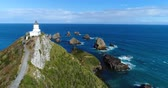 farol : New Zealand aerial drone footage of Nugget Point Lighthouse in Otago region and peninsula on South Island of New Zealand. Beautiful tourist destination and attraction seen from above.