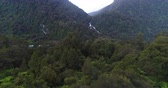 chuva : New Zealand nature landscape aerial drone video of Haast River and Roaring Billy Falls waterfall in Mount Aspiring National Park, South Island, New Zealand. Stock Footage