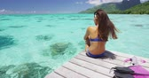 barbatanas : Luxury lifestyle vacation holiday travel bikini woman relaxing at ocean after snorkel swim at beach paradise. Girl serene at Tahiti resort in natural landscape, French Polynesia.