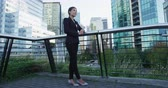 brasão : Business woman portrait of young female urban professional businesswoman in suit with arms crossed in Downtown Vancouver, BC, Canada. Confident successful multicultural Chinese Asian  Caucasian woman