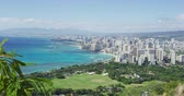 visto : Waikiki Beach and Honolulu city against sky during sunny day. Cityscape and sea are seen from Diamond Head State Monument. It is famous landmark in Oahu. Vídeos