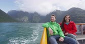 cestující : Cruise ship tourists on boat tour in Milford Sound, Fiordland National Park, New Zealand. Happy romantic couple on sightseeing travel honeymoon on New Zealand South Island.