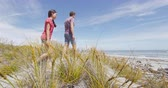 pântano : Couple walking on beach in New Zealand - people in Ship Creek on West Coast of New Zealand. Tourist couple sightseeing tramping on South Island of New Zealand. SLOW MOTION.