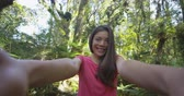 marais : Woman taking selfie video hiking in New Zealand kissing and waving hello to camera in swamp forest nature landscape in Ship Creek, West Coast of New Zealand. Happy tourist girl sightseeing New Zealand