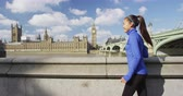 spojené království : Woman running in London in front of Big Ben. Female runner on Westminster Bridge. Multicultural Asian Caucasian girl jogging training in London City, England, United Kingdom.