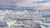 jakobshavn : Icebergs in Icefjord aerial drone video of amazing nature landscape on Greenland. Iceberg and ice in fjord from melting glacier. Ilulissat icefjord, Disko bay, Greenland. Affected by climate change. Stock Footage