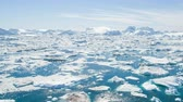 jakobshavn : Iceberg and ice from glacier in arctic nature landscape on Greenland. Aerial video drone footage of icebergs in Ilulissat icefjord. Affected by climate change and global warming. Stock Footage