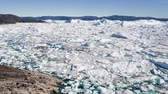 jakobshavn : Iceberg in arctic landscape nature with icebergs and ice in Greenland icefjord. Aerial drone footage video of ice and iceberg. Ilulissat Icefjord with icebergs from glacier. Stock Footage