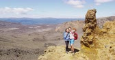 tongariro : Happy Couple Taking Selfie With Smartphone Hiking in Beautiful Mountains in Tongariro Alpine Crossing. Backpackers smiling at camera against in famous tourist destination landscape in New Zealand. Stock Footage