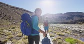 me : Happy Woman Backpacker Welcome You To Travel and Walk On New Zealand In Tongariro National Park Young female is hiking with man on tramping track. They are enjoying summer vacation in New Zealand. Stock Footage