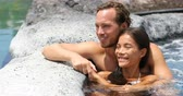 bain homme : Romantic couple relaxing together in hot tub whirlpool jacuzzi luxury resort spa retreat. Luxurious hotel travel vacation.