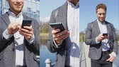 mensagens de texto : Smartphone - Young urban professional business man using phone walking in city Park. Vertical video of Businessman in 30s using smartphone app in urban park