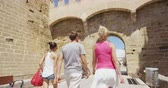 baleares : Friends walking on travel vacation together having fun Alcudia Old Town, Mallorca, Spain. Group of friends traveling together in Majorca on Europe vacation. Stock Footage