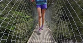 подвесной : Hiking. Woman in New Zealand, Abel Tasman National Park. Young traveller backpacking crossing swing bridge over Falls River