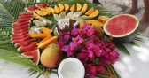 típico : Fruit arrangement - tahiti fruit table with coconut mango watermelon melons etc. Typical local tahitian food presentation from French Polynesia.