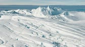 jakobshavn : Global Warming and Climate Change - Giant Iceberg from melting glacier in Ilulissat, Greenland. Aerial drone of arctic nature landscape famous for being heavily affected by global warming. Hyperlapse. Stock Footage