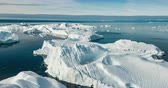 jakobshavn : Iceberg aerial drone video - Global warming and climate change concept. Giant icebergs in Disko Bay on greenland in Ilulissat icefjord from melting glacier Sermeq Kujalleq Glacier, Jakobhavns Glacier.