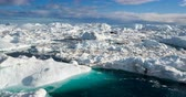 umweltverschmutzung : Global Warming and Climate Change - Icebergs from melting glacier in icefjord in Ilulissat, Greenland. Aerial video of arctic nature iceberg and ice landscape