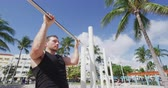 грудь : Fitness man doing pull ups chest to bar training working out muscles at outdoor gy. Стоковые видеозаписи