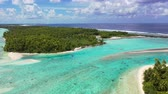 barışçı : Rangiroa aerial drone video of atoll island motu and coral reef in French Polynesia, Tahiti. Amazing nature landscape with blue lagoon and Pacific Ocean. Tropical island paradise in Tuamotus Islands. Stok Video