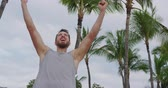 Strong fitness man on beach cheering celebrating flexing arms screaming excited for winning success. Muscular young male athlete flexing arms showing biceps muscles, Sexy caucasian model Dostupné videozáznamy