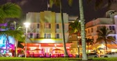 Miami Beach, Florida, USA on Ocean Drive at sunset with famous colorful art deco building. Hyperlapse timelapse video in 4K. Stok Video