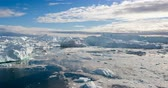 jakobshavn : Iceberg and ice from glacier in arctic nature landscape on Greenland. Aerial video drone video of icebergs in Ilulissat icefjord. Affected by climate change and global warming.