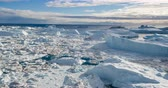 jakobshavn : Iceberg aerial footage - giant icebergs in Disko Bay on greenland floating in Ilulissat icefjord from melting glacier Sermeq Kujalleq Glacier, aka Jakobhavns Glacier. Global warming and climate change Stock Footage