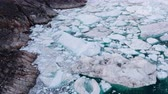 jakobshavn : Climate Change and Global Warming - Icebergs and from melting glacier in icefjord in Ilulissat, Greenland. Aerial video of arctic nature ice landscape.