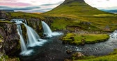 uzun pozlama : Iceland time lapse video of waterfall and famous mountain. Kirkjufellsfoss and Kirkjufell in northern Iceland nature landscape. Timelapse photography in 4K. 8K UHD available