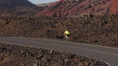 주기 : Road biking male cyclist biking on road bike cycling in amazing nature landscape. Professional cyclist athlete cycling riding bicycle training in Lanzarote, Canary Islands, Spain, Europe.