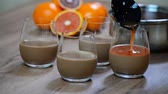 citrus fruit recipe : Panna cotta with orange jelly in the glass. Stock Footage