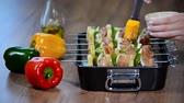 wood grill : Cooking chicken kebabs with vegetables.