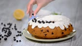 black currant : Decorating sponge cake with black currant.