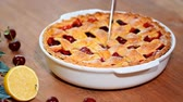 flaky : Delicious Homemade Cherry Pie with a Flaky Crust. Cutting a cherry pie