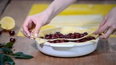 suculento : Ingredients for baking cake stuffed with fresh cherry pie. Female preparing cherry pie. Stock Footage