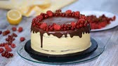 red currant : Pastry chef decorates a cake with berries.