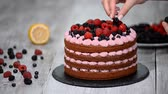 amoras : Chef decorate the cake wild berries.