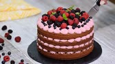 amoras : Cutting beautiful chocolate cake with fresh berry.