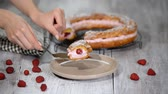 choux : Homemade choux pastry cake Paris Brest with raspberries. French dessert.
