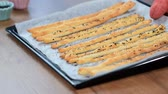 bundle of : Freshly baked, rustic Italian grissini bread sticks.Traditional Italian salty breadsticks sprinkled with poppy seeds.
