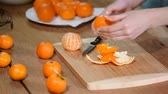 peau d orange : Woman hand peeling ripe sweet tangerine, close up.