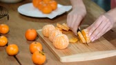 rind : Closeup of woman hands slicing lime tangerine. Stock Footage