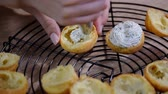 canape : Making profiteroles with a cream cheese filling.