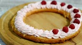 chantilly : Woman in the kitchen making Paris Brest with raspberry. Vídeos