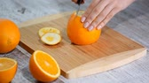 grejpfrut : Peeled orange on wooden cutting board.