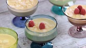 indulgence : Dessert with caramel cream and mousse with raspberries in a glass.