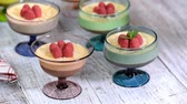 Chocolate dessert in glasses with raspberries. Chocolate mousse or pudding in portion glasses with fresh berries, copy space