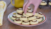Shortbread cookies in form of mushrooms. Sweet cookies in bowl Wideo